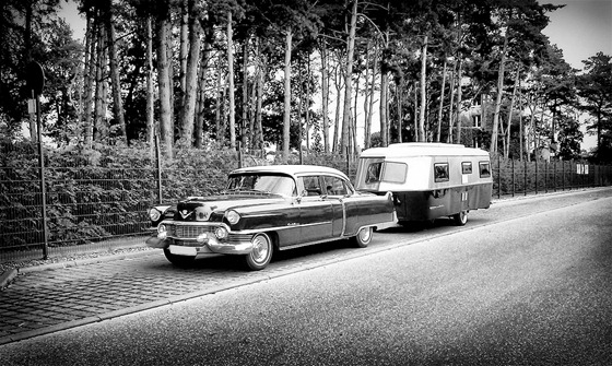 This beautiful Cadillac with matching trailer was on the edge of a roadside camp in Germany.