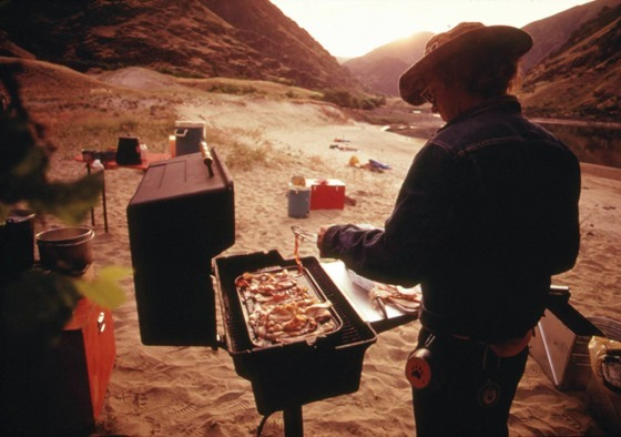 Breakfast at campsite on the Snake River in Hells Canyon. With the growing popularity of river trips..., 05-1973